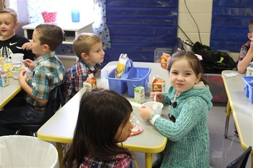 Photo of elementary students enjoying free breakfast